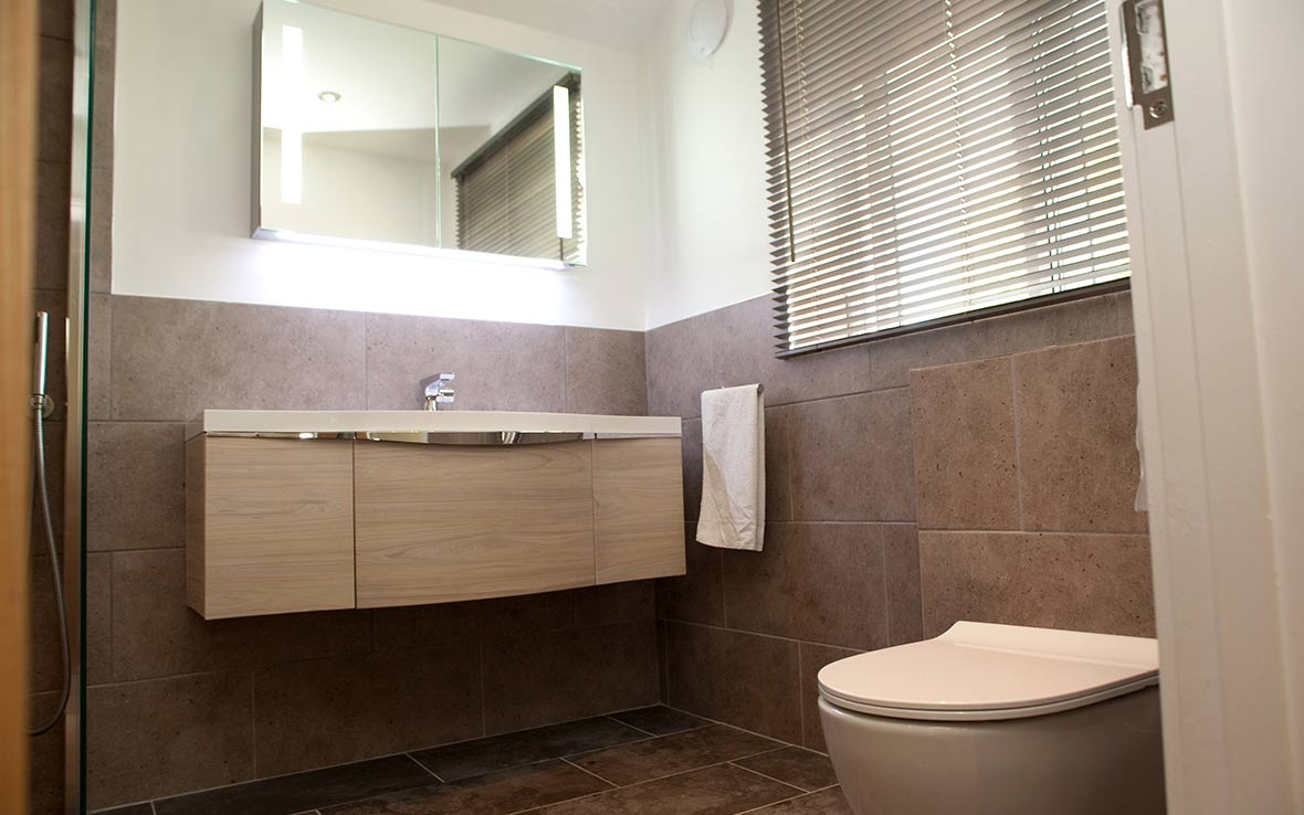 Low-profile floating WC contributes to an uncluttered look