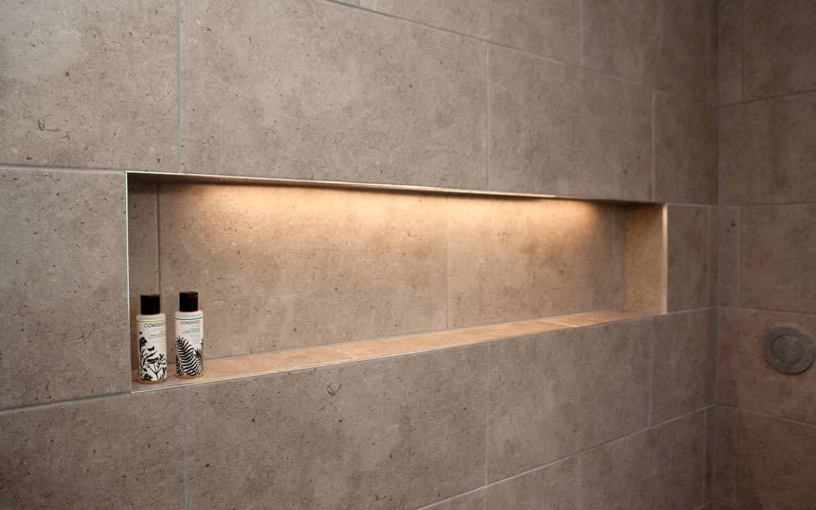 Shower recess with LED lighting and storage