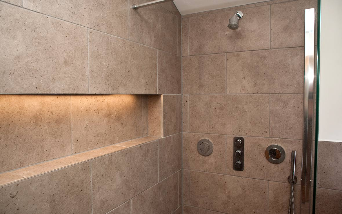 Shower options include body jets, powerful hand-held wand and directional overhead