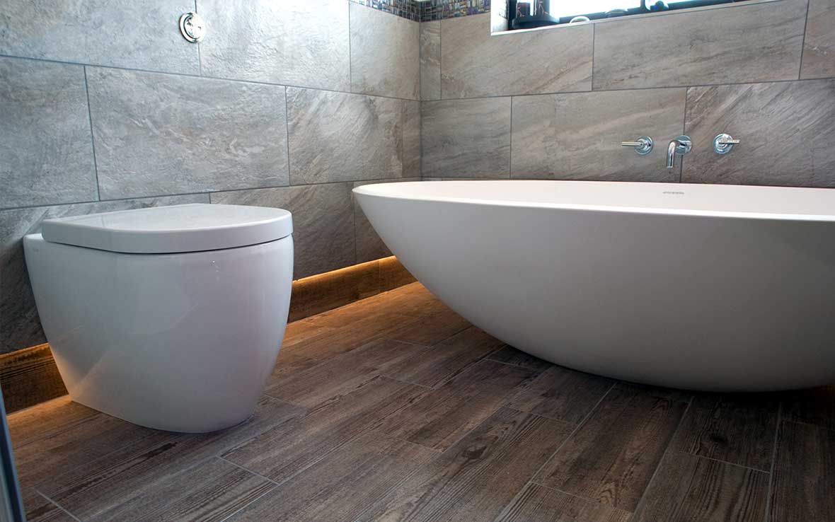 Concealed LED ambient lighting and wood-effect tiled floor