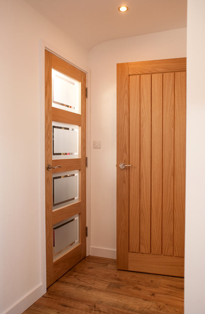 Contemporary-style oak doors with brushed door furniture
