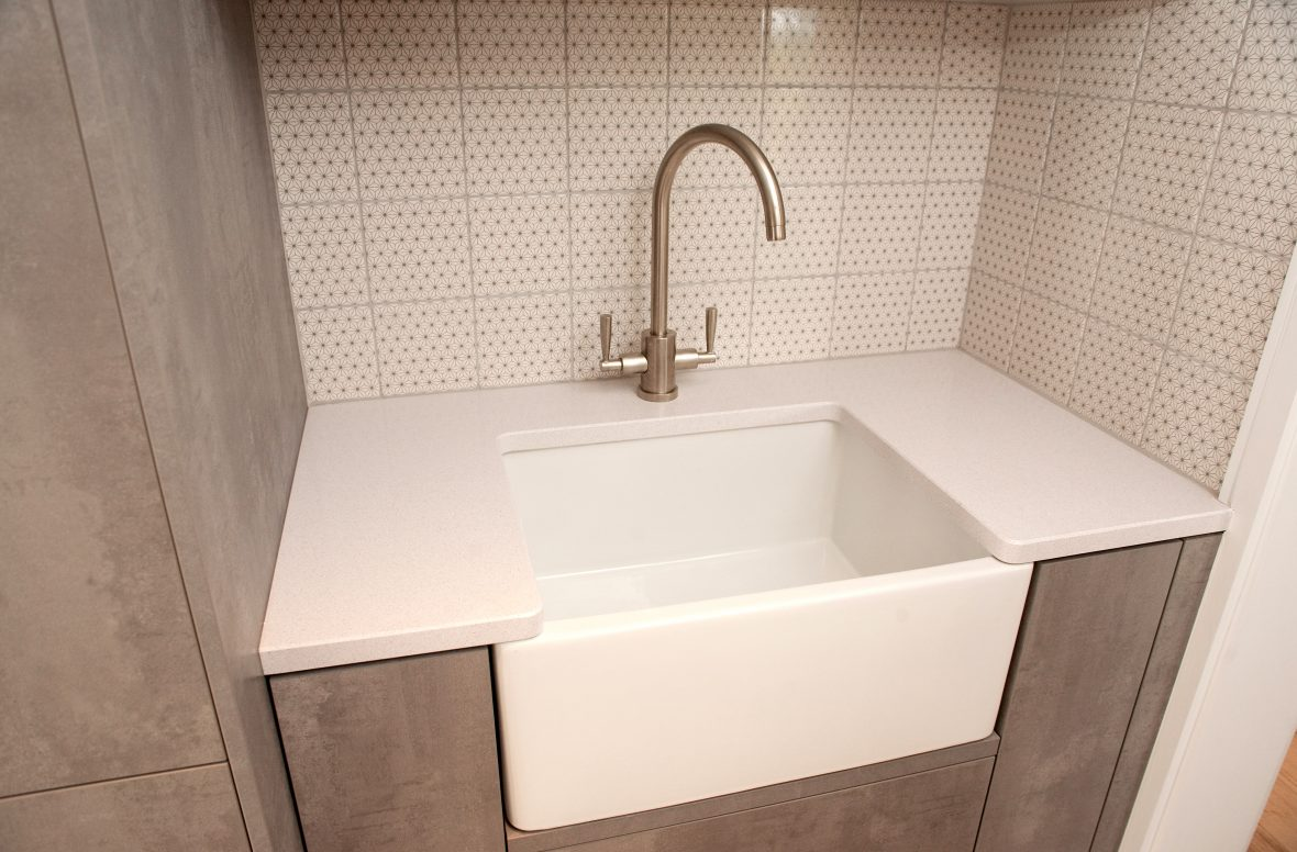 Basin in utility room with high-quality Franke monobloc tap