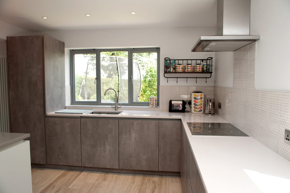 Tall unit conceals big fridge, dishwasher and recycling sorting in lower units. Franke tap and sink.