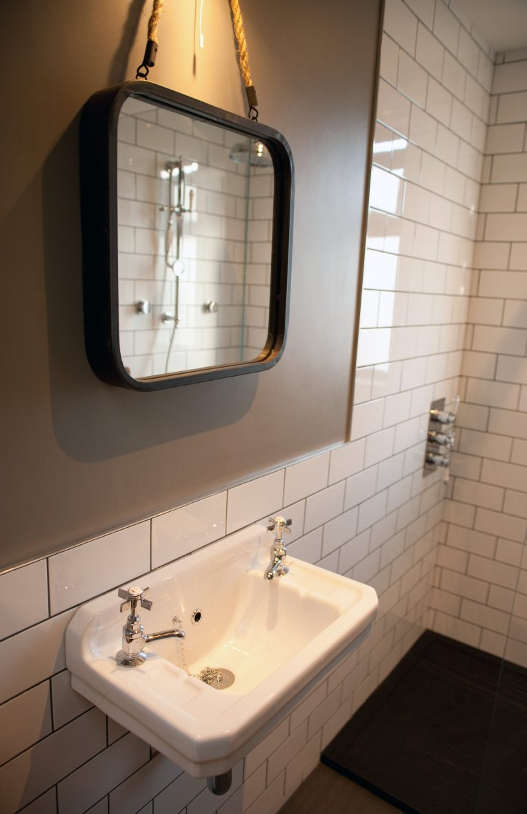 En-suite bathroom with victorian-style full tiling and matching accessories.