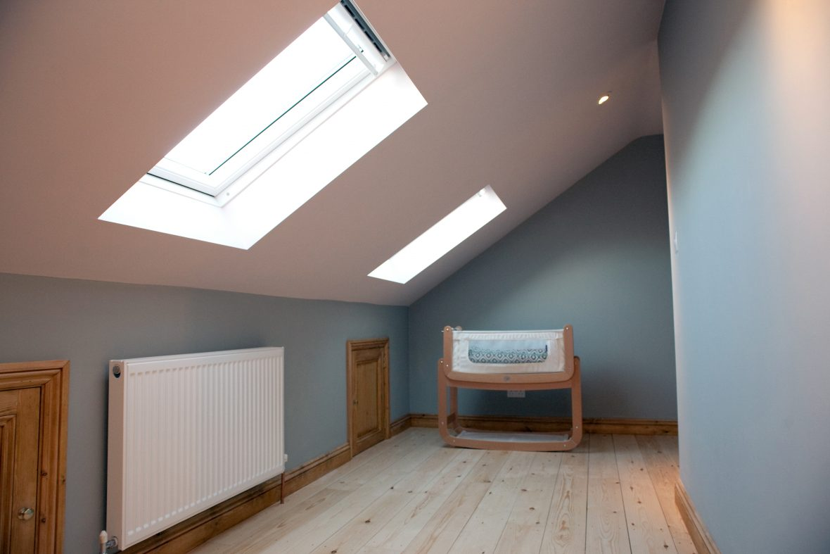 One of the two bedrooms is a nursery with bespoke panelled doors leading to storage area.