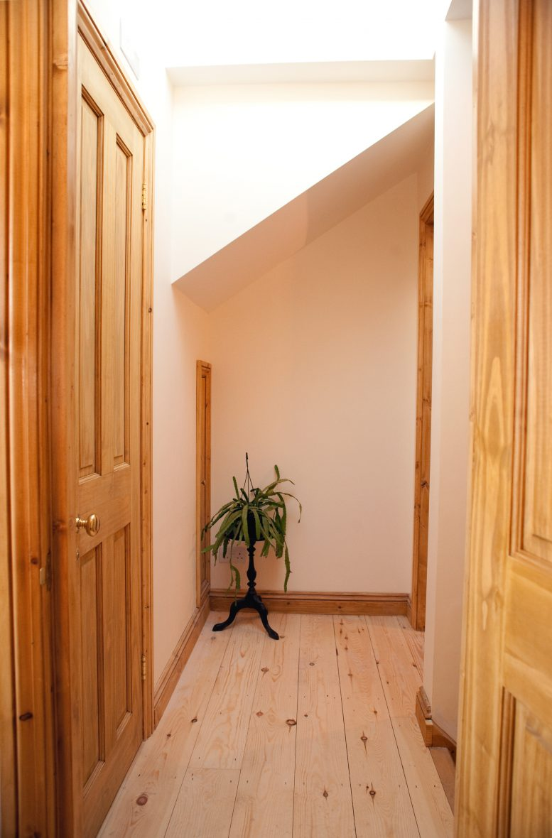Landing area at top of new staircase shows doors to the master bedroom, nursery, en-suite bathroom and additional storage area.